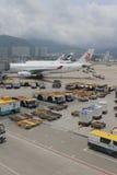 Passenger aircraft on the runway of Hong Kong. The Passenger aircraft on the runway of Hong Kong stock photo