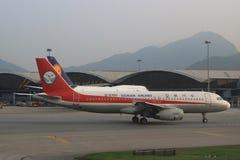 Passenger aircraft on the runway of Hong Kong. A Passenger aircraft on the runway of Hong Kong International Airport site stock images