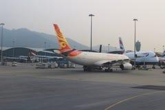 Passenger aircraft on the runway of Hong Kong stock photos
