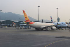 Passenger aircraft on the runway of Hong Kong. A Passenger aircraft on the runway of Hong Kong International Airport site stock photos