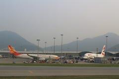 Passenger aircraft on the runway of Hong Kong. A Passenger aircraft on the runway of Hong Kong International Airport site royalty free stock photo
