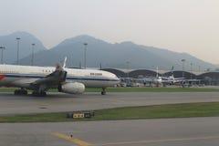 Passenger aircraft on the runway of Hong Kong. A Passenger aircraft on the runway of Hong Kong International Airport site royalty free stock image
