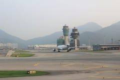 Passenger aircraft on the runway of Hong Kong royalty free stock photos