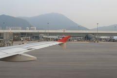 Passenger aircraft on the runway of Hong Kong. A Passenger aircraft on the runway of Hong Kong International Airport site stock photography