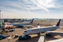 Passenger aircraft at Schiphol Airport. Delta and British Airways passenger aircraft at Schiphol Airport, Amsterdam, the Netherlands Royalty Free Stock Photography