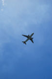 Passenger aircraft in the sky. Freedom of flying in the blue sky Royalty Free Stock Photo