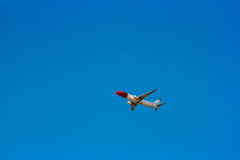 Passenger aircraft in the sky Royalty Free Stock Photo