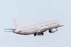 Passenger aircraft after take off Stock Photos