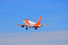 Passenger Aircraft With Undercarriage Down. New Easyjet Colours. An Easyjet plane soars into the distance not long after departing from Alicante Airport in Spain Royalty Free Stock Photography