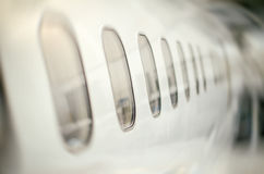 Passenger aircraft windows. Royalty Free Stock Photos