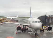 Passenger aircrafts in the Copenhagen airport stock image