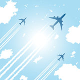 Passenger aircrafts flying in sky Royalty Free Stock Photos
