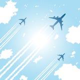 Passenger aircrafts flying in sky. Passenger aircrafts flying in blue sky Royalty Free Stock Photos