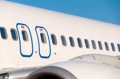 Passenger airline. Windows from outside Stock Photos