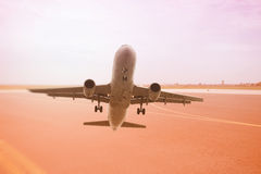 Passenger Airline taking off from airport Stock Photography