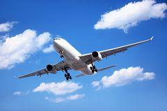 Passenger Airliner Arrival. Airplane in the cloudy sky,Passenger Airliner Arrival Stock Photo