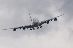 Passenger airliner in bad weather Royalty Free Stock Images