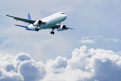 Passenger airliner flies above the clouds Stock Photo