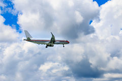Passenger airliner flight in the blue sky Royalty Free Stock Photos
