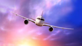 Passenger Airliner flying in the clouds Royalty Free Stock Photo