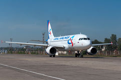 Passenger airliner goes to the start to `lane 22`. Airplane A319 of the Ural Airlines, Rostov-on-Don, Russia, August 25, 2014 royalty free stock photography