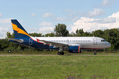 Passenger airliner goes to the start to `lane 22`. A319 rolls to the start, Rostov-on-Don, Russia, July 15, 2015 Royalty Free Stock Photo