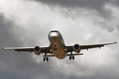 Passenger airliner landing in stormy day Stock Image