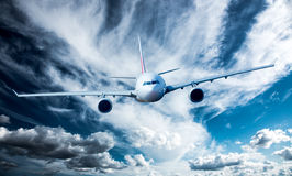 Passenger Airliner in the sky. Passenger Airliner flying in the clouds Stock Image