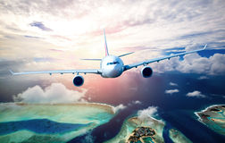 Passenger Airliner in the sky. Passenger Airliner flying in the clouds Royalty Free Stock Photography