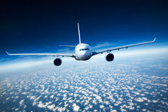 Passenger Airliner in the sky Royalty Free Stock Photos