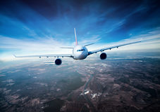 Passenger Airliner in the sky Royalty Free Stock Image