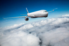 Passenger Airliner in the sky Stock Photo