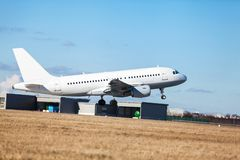 Passenger airliner taking off at an airport Stock Photo