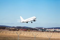 Passenger airliner taking off at an airport Royalty Free Stock Photography