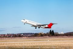 Passenger airliner taking off at an airport Stock Images