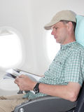Passenger in airplane Stock Photography