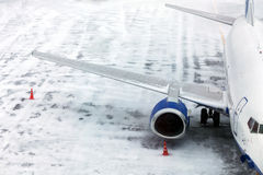 Passenger Airplane on airfield winter Royalty Free Stock Image