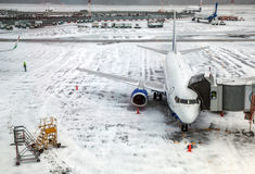 Passenger Airplane on airfield winter Stock Images