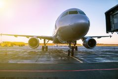 Passenger airplane at the airport apron in the morning sun. Passenger aircraft at the airport apron in the morning sun stock image