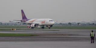 Passenger airplane at Bangkok Airport royalty free stock image