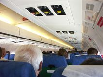 On passenger airplane board Stock Images