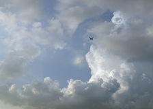 Passenger airplane in clouds Stock Photo