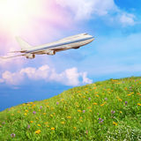 Passenger airplane in the clouds Stock Images