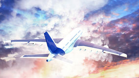 Passenger airplane in the clouds at sunset. travel by air transport. Stock Image