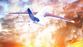 Passenger airplane in the clouds at sunset. travel by air transport. Stock Photo