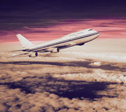 Passenger airplane in the clouds. Stock Photography