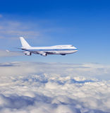 Passenger airplane in the clouds. Royalty Free Stock Photography