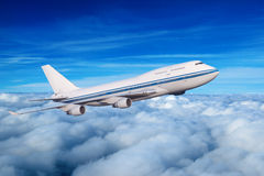 Passenger airplane in the clouds. Royalty Free Stock Photo