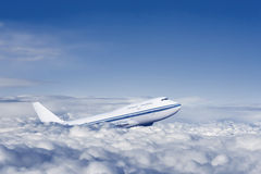 Passenger airplane in the clouds. Royalty Free Stock Image