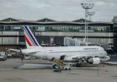 Passenger airplane docking at Paris Orly Airport royalty free stock photography